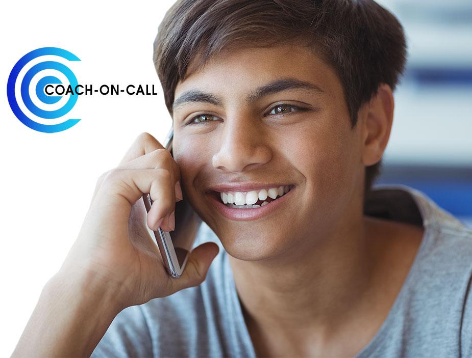 PEAK-coach-on-call-phone-swim-coaching-boy-on-phone